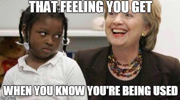 Hilary Clinton with black girl racist meme